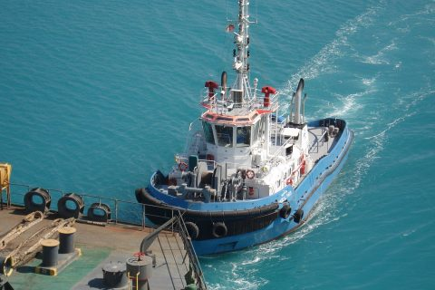 Tugboat approaching vessel at Ras Laffan Port