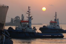View of NSW tugboats in process of vessel escorting at Ras Laffan Port