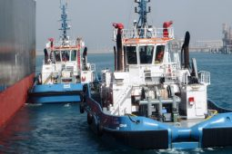 Tugboats appraoching vessel to assist entry into Ras Laffan Port